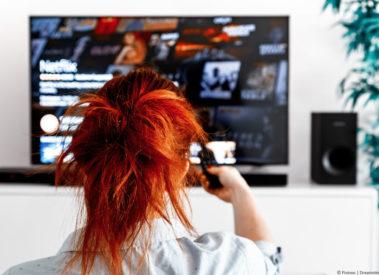 Lady watching Netflix on TV